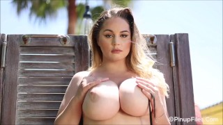 Sultry all-natural 34J Holly Garner teases you with her body