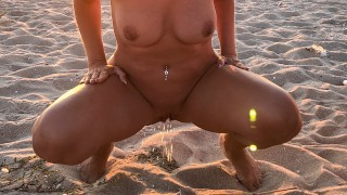 Tanned girl pees on public naked beach! Oh yes I love to piss in public