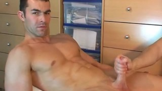 Straight soccer player gets wanked his big dick by us in spite of himself
