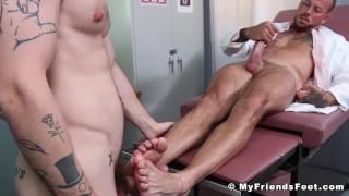 Bearded stud foot fucks his buddy while he masturbates