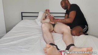 Bound amateur has his body tickled by dominant black stud