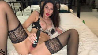 Hot MILF LIZA VIRGIN cums with a squirt playing with a vibrator at home on the bed