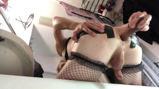 Cute femboy with anal toy in the bathroom