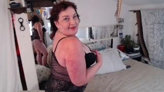 V695 beautiful redhead DawnSkye flirting in a gartered black lace teddy kissing and titties