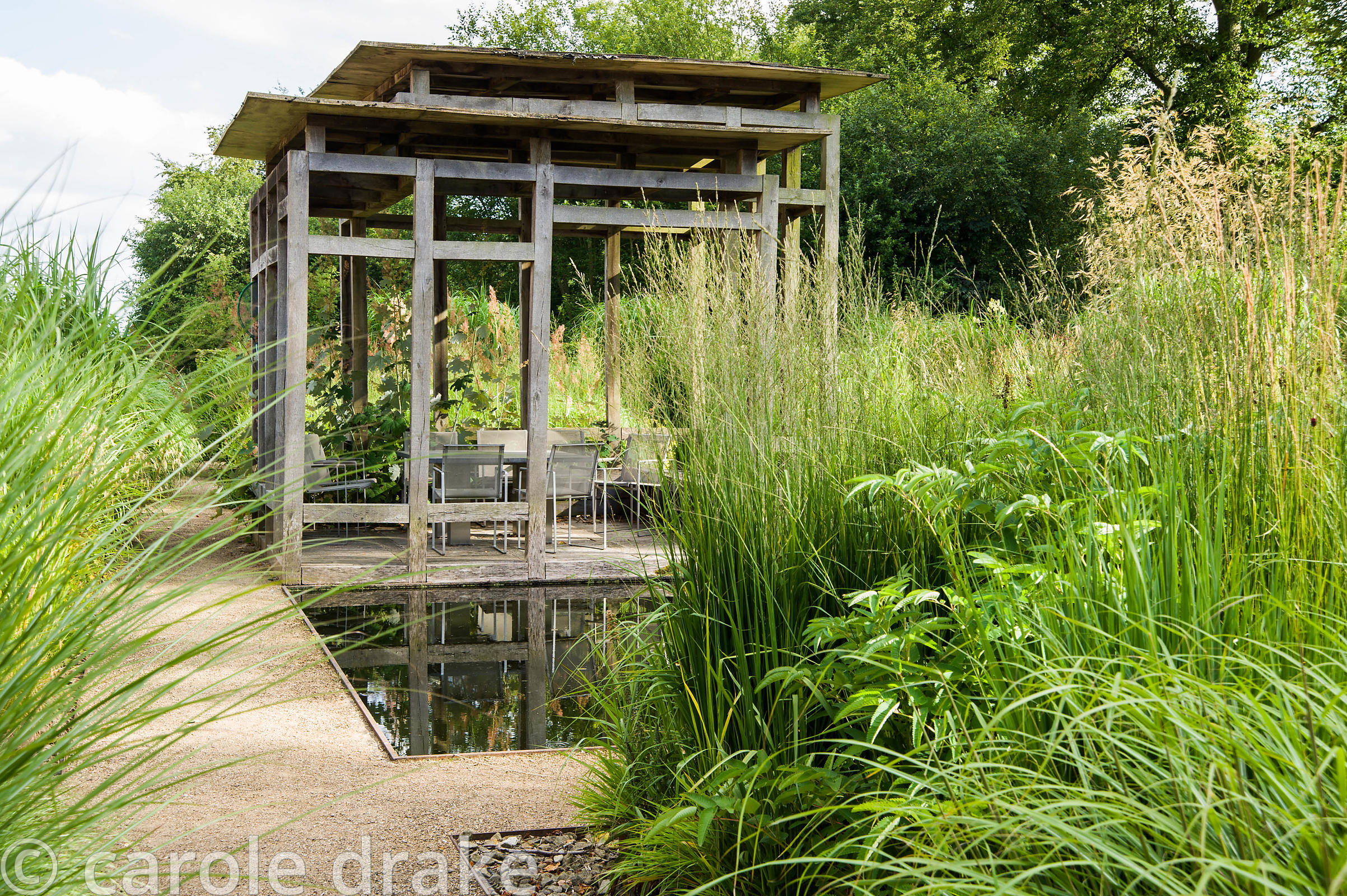 Carole Drake At The Centre Of The Minimalist Front Garden Designed By Christopher Bradley Hole Is A Contemporary Green Oak Summerhouse B