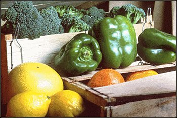 Fruit and Vegetables in crates and boxes.