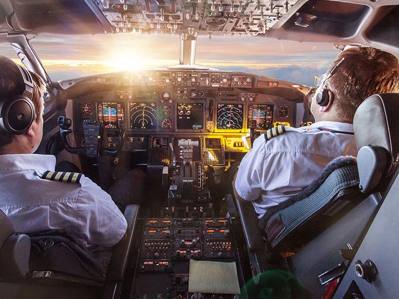 Pilots in cockpit of commercial flight