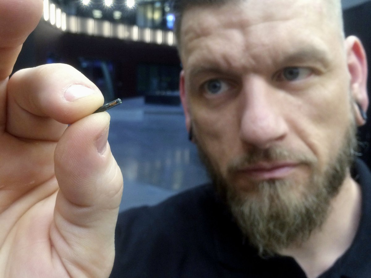"Has ""modding"" ones body finally hit the mainstream? Thousands Of Swedes Are Inserting Microchips Under Their Skin"