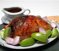 Walnut-Stuffed Turkey Breast with Cider Gravy recipe photo from the Diabetic Gourmet Magazine diabetic recipes archive.