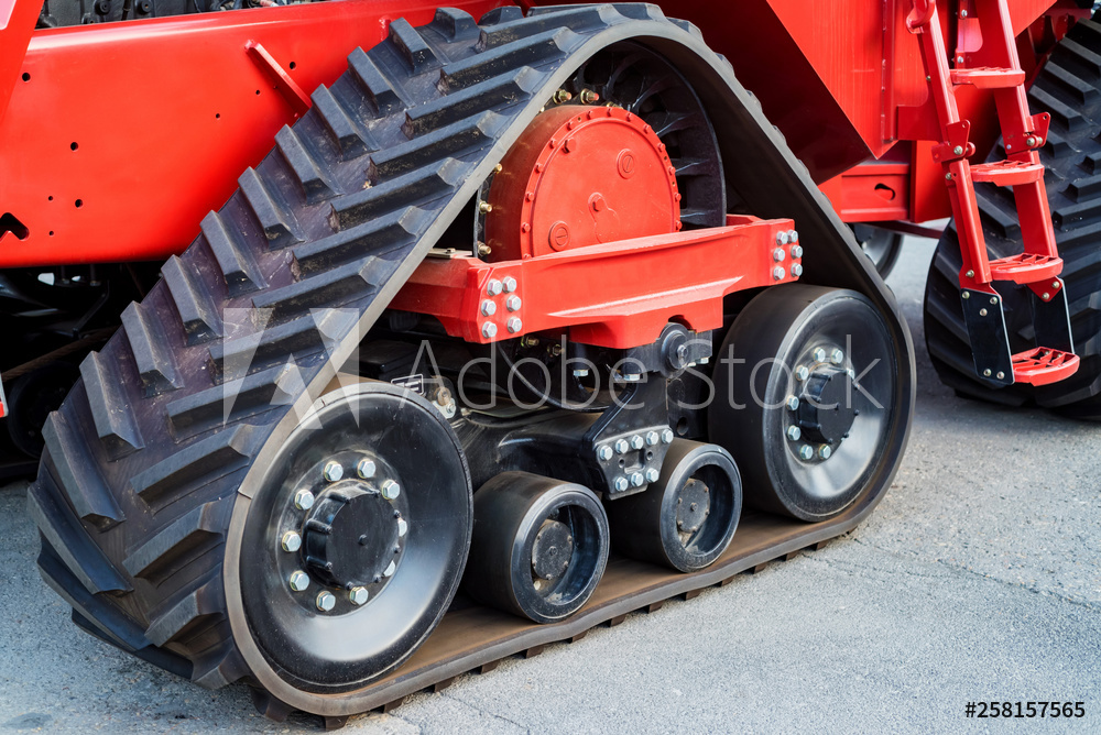 A close up of modern rubber tractor tracks