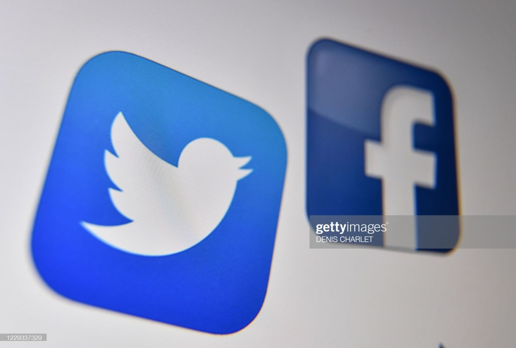 A photo taken on October 21, 2020 shows the logo of the the American online social media and social networking service, Facebook and Twitter on a computer screen in Lille. - A powerhouse line-up of earnings releases on Thursday is expected to show that giants of Big Tech are on firm financial footing despite turbulent politics and the coronavirus pandemic. Amazon, Apple, Facebook, Twitter and Google-parent Alphabet are all slated to disclose how their businesses faired in the third quarter of this year. (Photo by Denis Charlet / AFP) (Photo by DENIS CHARLET/AFP via Getty Images)