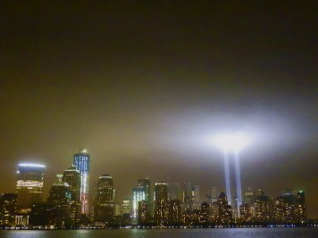 The Tribute in Light from across the Hudson River in Jersey City. The new 1 World Trade Center, bathed in red, white, and blue, is on the left side of this photo.