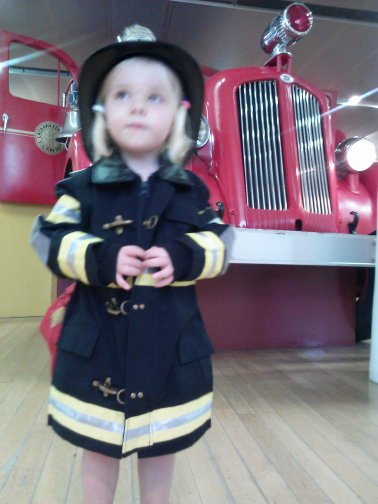 Fiona dresses up like a firefighter at the Staten Island Children's Museum.