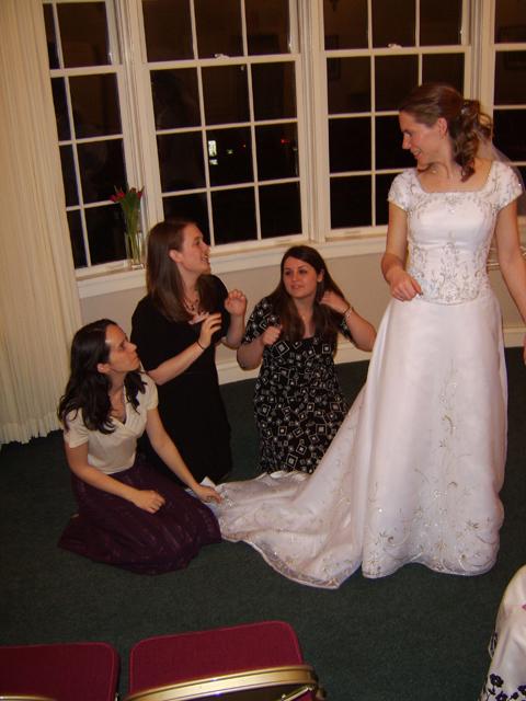 Andrada, Megan, and Lindsay hide under the train of Susan's dress.