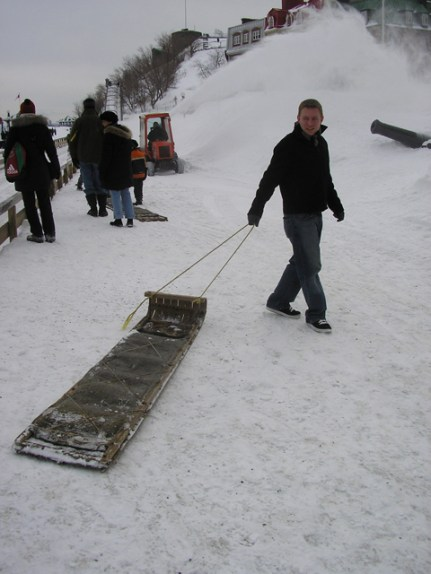 Dustin hauls a toboggan to the top of the run set up on the Terrasse Dufferin in front of the Château Frontenac.