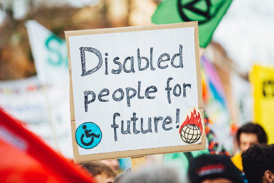A placard in a protest states 'Disabled people for future!'
