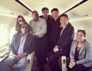 Minister Joseph Harmon (seated, left) no a private jet with representatives from loggers BSL and Rong-An Inc (image courtesy of Kaieteur news)