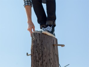 Person standing on a pole