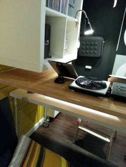 A large, protruding shelf isn't ideal over a small desk.