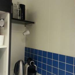 This corner coffee station is almost unusable due to the tall cabinet installed directly beside it. Try to allow yourself standing room!