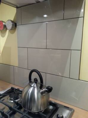 Stick to using a continuous line for your splashback, rather than only covering sections of wall.