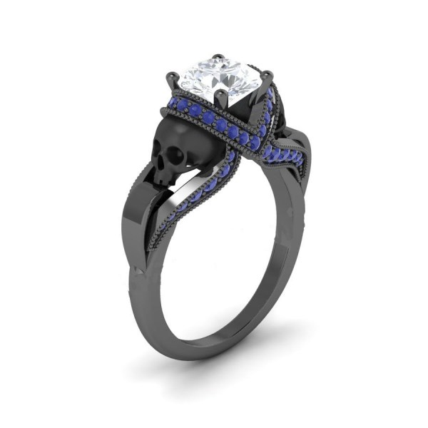 White & blue diamond black skull ring