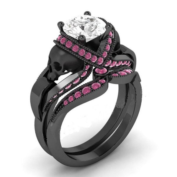 Pink & white diamond black skull ring