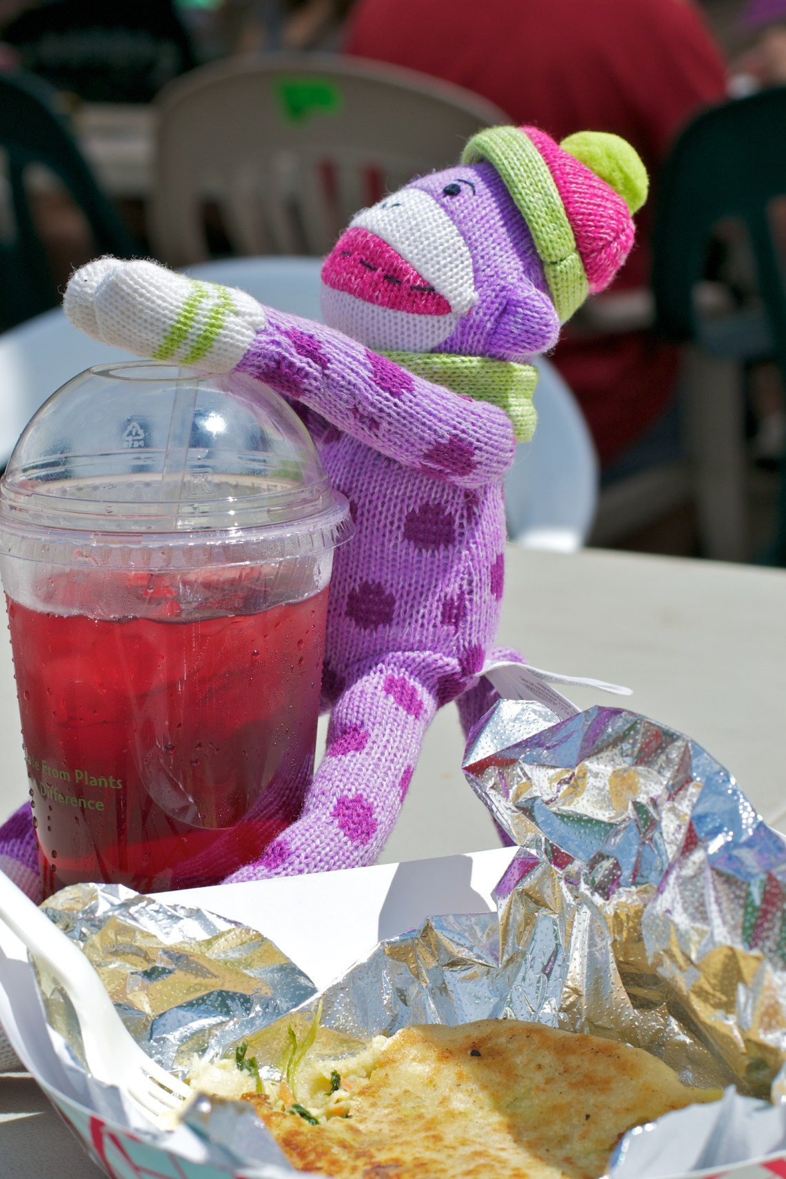 Sock Monkey Enjoys Lunch at the Farmers Market