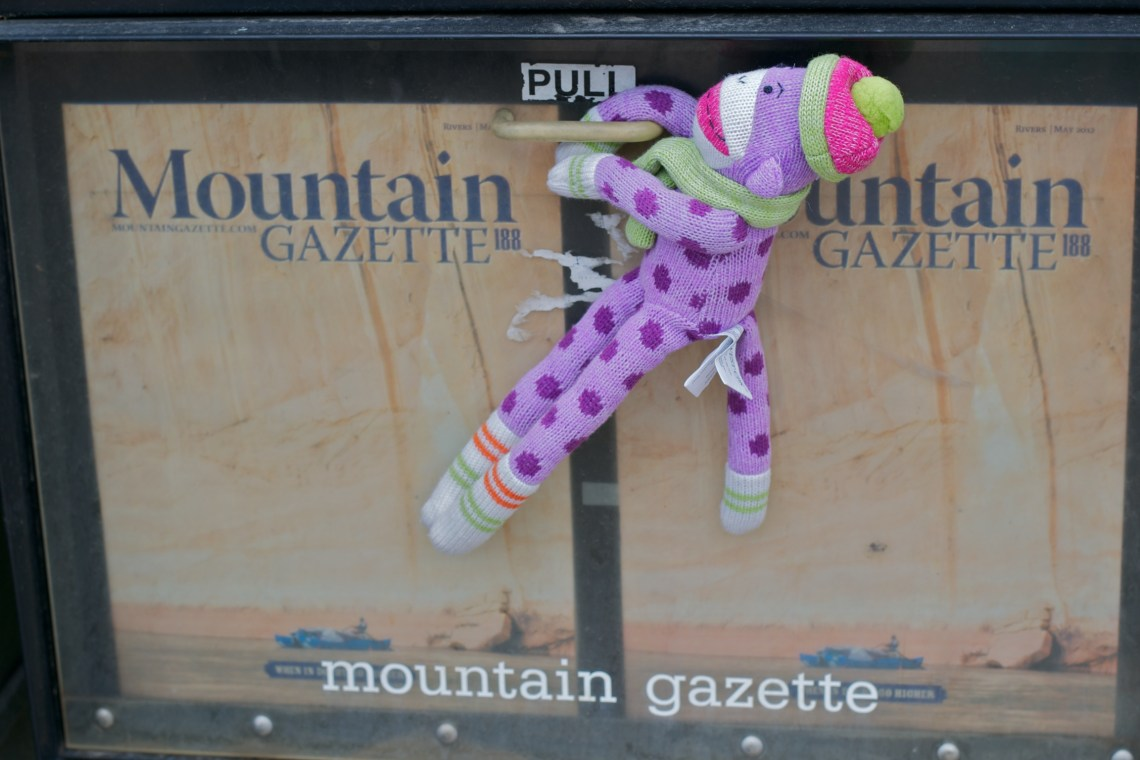 Sock Monkey Reaching for the Mountain Gazette