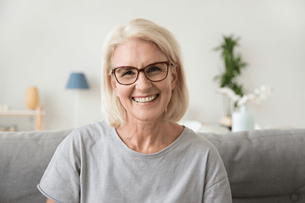 Smiling happy patient with glasses