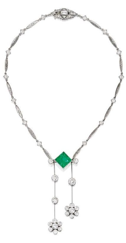 A platinum, emerald and diamond lavallière, circa 1930. Via Diamonds in the Library.