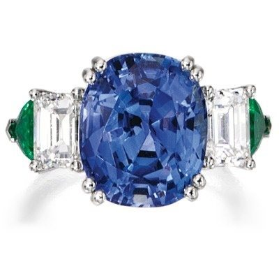 Sapphire, diamond, and emerald ring. Via Diamonds in the Library.