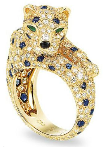 A diamond, sapphire, and emerald panther ring by Cartier. Via Diamonds in the Library.