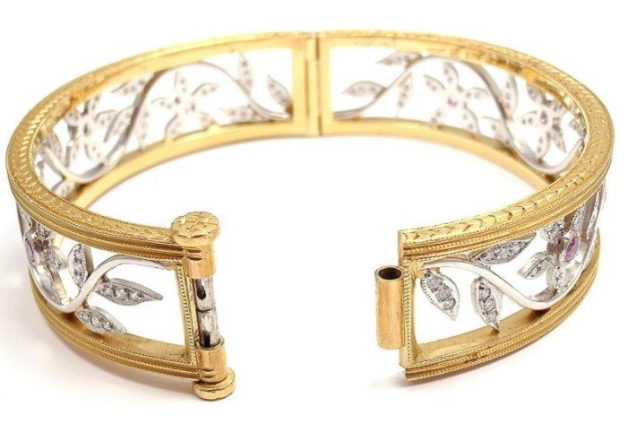 Back view; Cathy Waterman 22k gold, platinum, diamond, and pink sapphire bangle. Via Diamonds in the library.