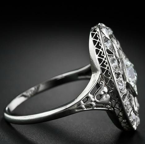 Shoulder detail; Edwardian diamond dinner ring at Lang Antiques. Via Diamonds in the Library.