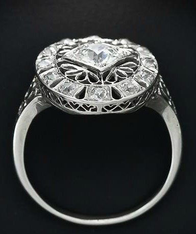 Side view; Edwardian diamond dinner ring at Lang Antiques. Via Diamonds in the Library.