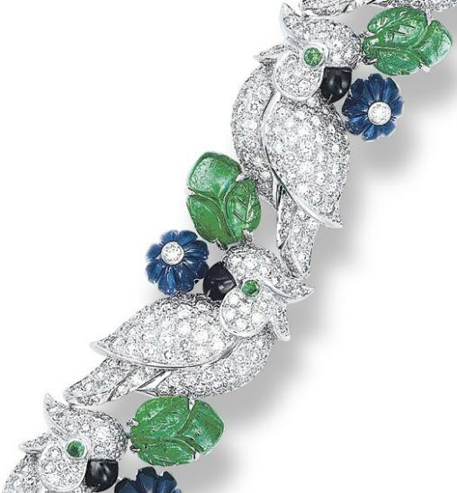 Zoom view - Cartier diamond, emerald, and sapphire bird bracelet.  Via Diamonds in the Library.