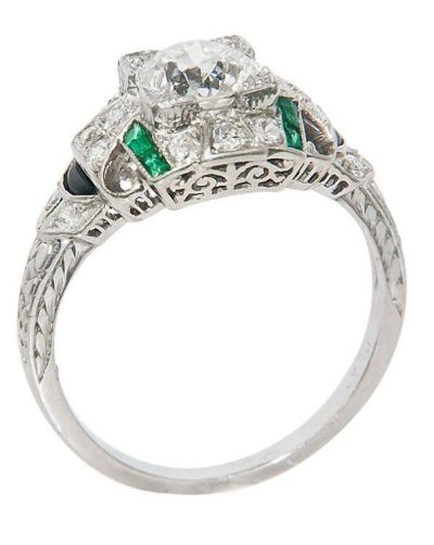 An Art Deco platinum, diamond, emerald and onyx engagement ring. Circa 1930's. Via Diamonds in the Library.