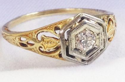 Antique Edwardian diamond ring in white and yellow gold.