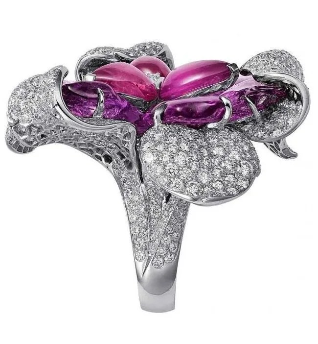 Cartier orchid ring in white gold with pink and purple sapphires and brilliant-cut diamonds.  Via Diamonds in the Library.
