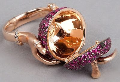 Open view; Stephen Webster poison apple ring - a poison (locket) ring in the shape of a ruby apple with diamond accents.