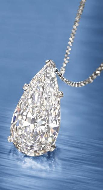 17.62 carat D color, flawless clarity diamond pendant on a necklace. Via Diamonds in the Library.