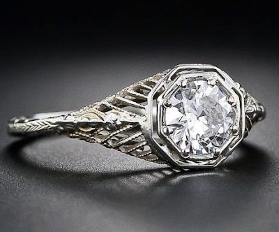 A 1920's filigree diamond engagement ring with a .56 carat old european cut diamond. Via Diamonds in the Library.