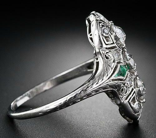 Antique Art Deco diamond calibre emerald dinner ring, circa 1930's. Via Diamonds in the Library.