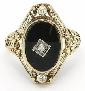 Art Deco black onyx and diamond filigree ring in 18K yellow gold.