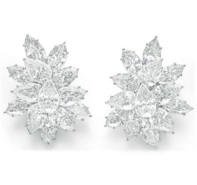 Diamond earrings by Harry Winston. Made up of 26 diamonds, all D color, all internally flawless clarity, totaling 50.48 carats. Via Diamonds in the Library.