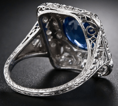 Gallery view; early Art Deco sapphire and diamond filigree ring. Via Diamonds in the Library.