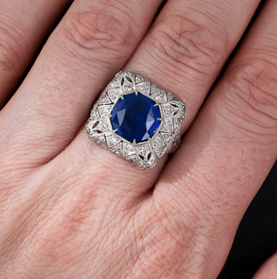 On a hand; early Art Deco sapphire and diamond filigree ring. Via Diamonds in the Library.