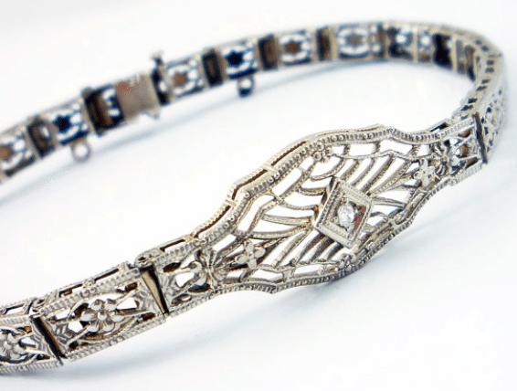 10K Belais Brothers white gold antique Art Deco diamond filigree bracelet. Via Diamonds in the Library.