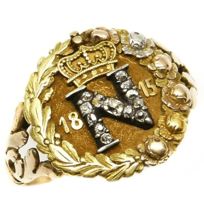 Early 19th century diamond and coloured gold commemorative ring for Napoleon I, circa 1815. Via Diamonds in the Library.